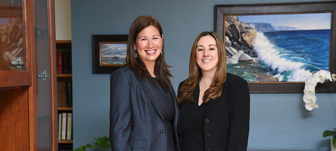 Summer Young-Agriesti and Ana Thomas of KBY Law in the law office conference room