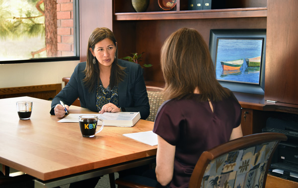 Attorney Summer Young-Agriesti talking with a client