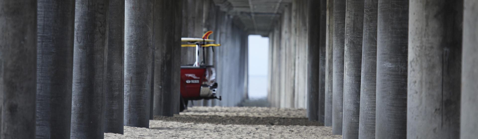 Lifeguard truck under pier in Newport Beach